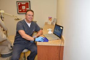 dentist using intraoral camera